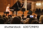 spectators in concert hall... | Shutterstock . vector #630729893