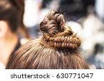 snail braid on womans head.... | Shutterstock . vector #630771047