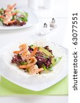 Fresh green salad with grilled shrimps on a spit - stock photo