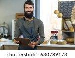 portrait of salesman holding... | Shutterstock . vector #630789173