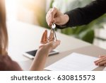 young lady taking keys from... | Shutterstock . vector #630815573