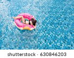 A  Young Woman Swimming On The...