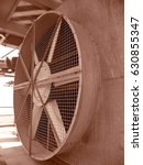 Small photo of big cooler fan of booster gas compressor on wellhead platform
