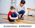 father and son hammering nails | Shutterstock . vector #630863663