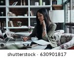 making notes. thoughtful young... | Shutterstock . vector #630901817