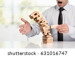 Small photo of Businessman Fails Building Tower, Concept For Challenge And Fail In Business