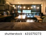 empty wood table in front of... | Shutterstock . vector #631070273