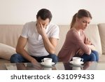 family couple sitting on the... | Shutterstock . vector #631099433