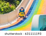 a boy in a life jacket slides... | Shutterstock . vector #631111193