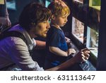 father and son look at the fish ...   Shutterstock . vector #631113647