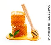 honeycomb with honey dipper... | Shutterstock . vector #631123907