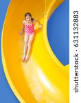 cute girl riding down a yellow... | Shutterstock . vector #631132883