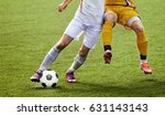 soccer player legs in action  | Shutterstock . vector #631143143
