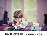 cute little boy lying on bed... | Shutterstock . vector #631177943