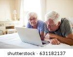 senior couple using laptop on... | Shutterstock . vector #631182137