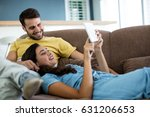 couple using digital tablet in... | Shutterstock . vector #631206653