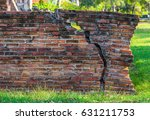 red brick wall with a big crack ... | Shutterstock . vector #631211753