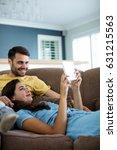 couple using digital tablet in... | Shutterstock . vector #631215563