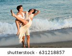 young happy couple walking in a ... | Shutterstock . vector #631218857