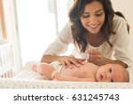 young mother moisturizing baby...   Shutterstock . vector #631245743