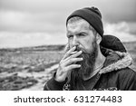 man smoking cigarette  young... | Shutterstock . vector #631274483