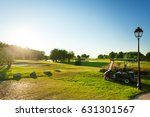 green golf course with golf... | Shutterstock . vector #631301567