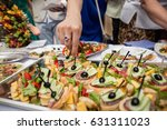 street food  canape on table ... | Shutterstock . vector #631311023
