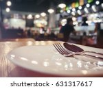 fork and spoon on plate dining... | Shutterstock . vector #631317617
