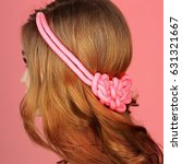 Small photo of Fashion shot of young beautiful woman with lon red curly hair. Rope jewelry accessorise on head.