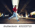 man in red hoodie running under ... | Shutterstock . vector #631323713