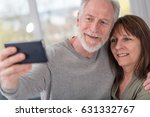 happy mature couple taking a... | Shutterstock . vector #631332767