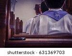 Priests Sitting In Church Pews...