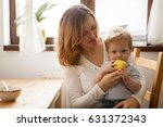 little kid trying to eat an... | Shutterstock . vector #631372343
