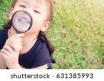 little girl child holding... | Shutterstock . vector #631385993