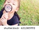 little girl child holding... | Shutterstock . vector #631385993