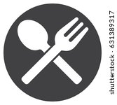 crossed fork and spoon on dish...   Shutterstock .eps vector #631389317