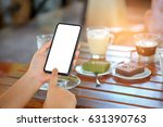 smart phone in hand with coffee ... | Shutterstock . vector #631390763