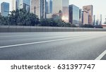 empty asphalt road of a modern... | Shutterstock . vector #631397747