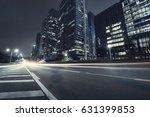 the traffic light trails of city | Shutterstock . vector #631399853