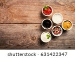 bowls of various dip sauces on... | Shutterstock . vector #631422347