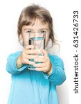 the child holds a glass of... | Shutterstock . vector #631426733