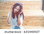 young beautiful woman listen... | Shutterstock . vector #631440437