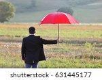 businessman with a red umbrella ... | Shutterstock . vector #631445177