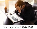 stressed businessman sitting at ... | Shutterstock . vector #631449887