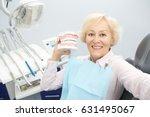 senior woman smiling joyfully... | Shutterstock . vector #631495067