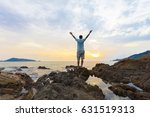 man with raised up arms at the... | Shutterstock . vector #631519313