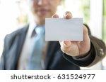 man's hand showing business... | Shutterstock . vector #631524977