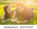 couple listening to music on... | Shutterstock . vector #631571627