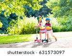 children learn to ride scooter... | Shutterstock . vector #631573097