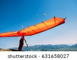 Man With Hang Glider Start To...